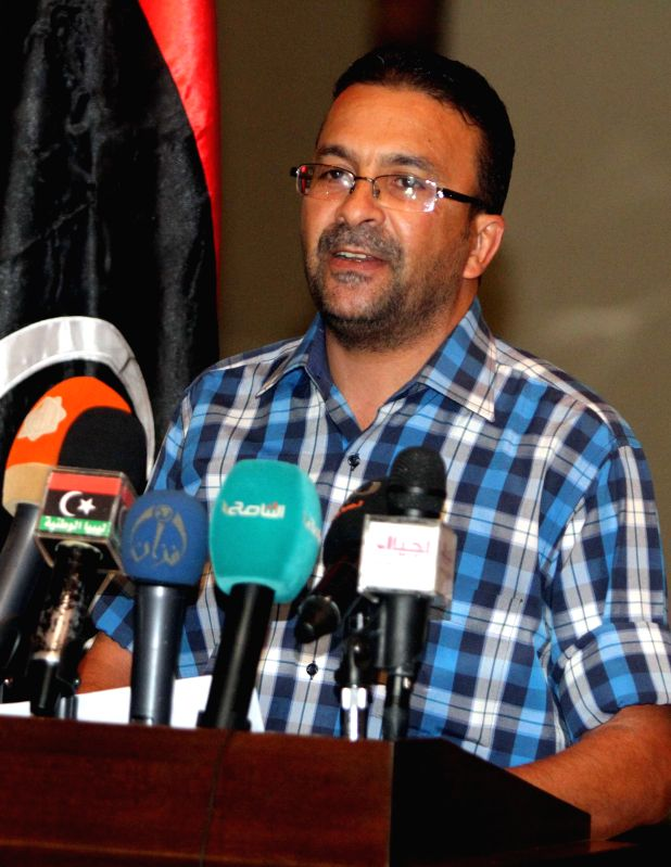 Ahmed Hadia, spokesman for the Islamist coalition forces Libya Dawn addresses a press conference in Tripoli, Libya, on Aug 23, 2014. The spokesman said their ...