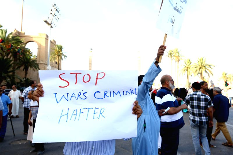 Local residents hold banners and chant slogans in the streets in Tripoli, Libya on August 8, 2014. Hundreds of Tripoli citizens on Friday took to the street to back .