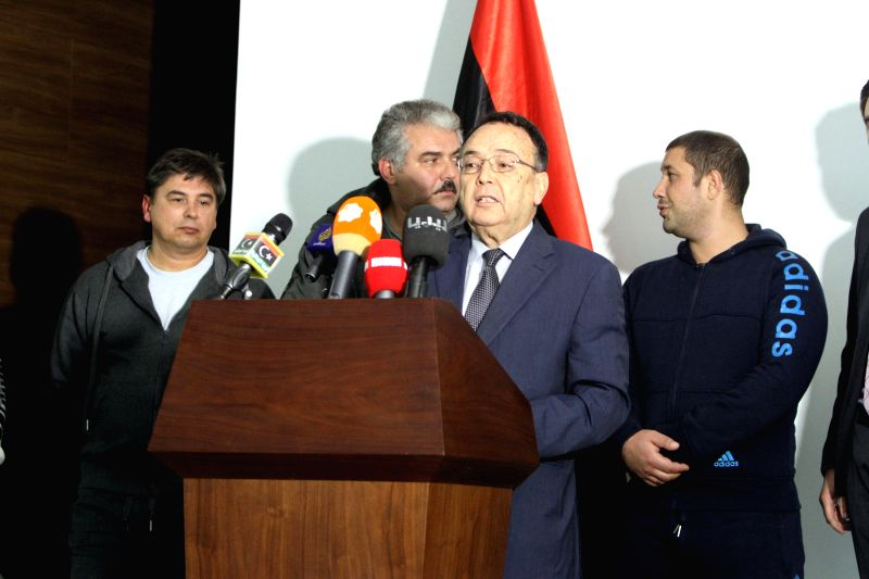 Mohamed Al-Ghirani(front), foreign minister of Islamist-backed government which controls the capital Tripoli attends a news conference in Tripoli, Libya, Dec. 16, ..