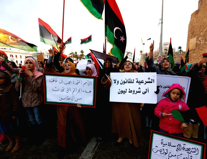 Hundreds of Libya Dawn supporters protest against the national army's recent air raids in the Martyr Square in Tripoli, Libya, on Dec. 26, 2014. Libya's national ...