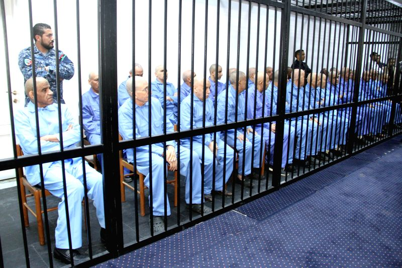 Former Libyan government officials are seen in court in Tripoli, capital of Libya, on Dec. 28, 2014. The court on Sunday continued the trial of dozens of senior ...