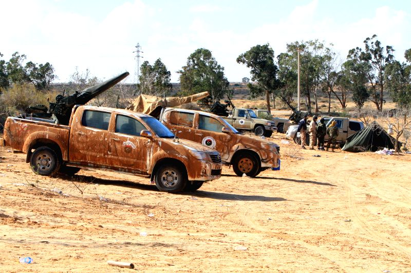 Some Libya Dawn fighters' military trucks are deployed near Wetia airbase, Libya, on Dec. 30, 2014. Libyan government forces on Tuesday announced that the air force