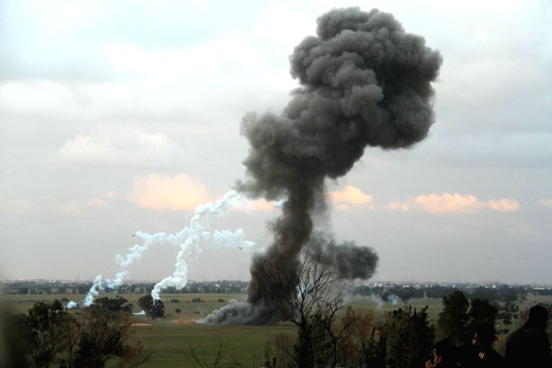 Smoke rises from the detonation site near Tripoli, Libya, on Feb. 10, 2015. A team of Libyan sappers on Tuesday collected and detonated a batch of unexploded shells