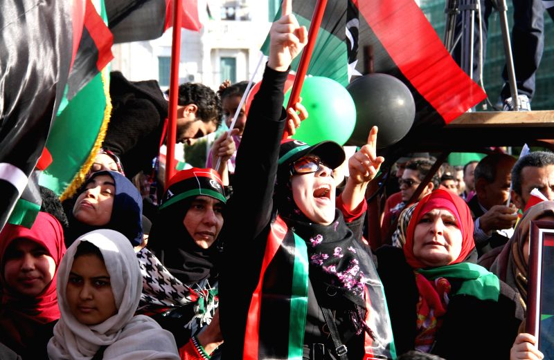 People chant slogans on Martyrs Square in Tripoli, Libya, on Feb. 17, 2015. Citizens on Tuesday celebrated the fourth anniversary of a political upheaval that ...