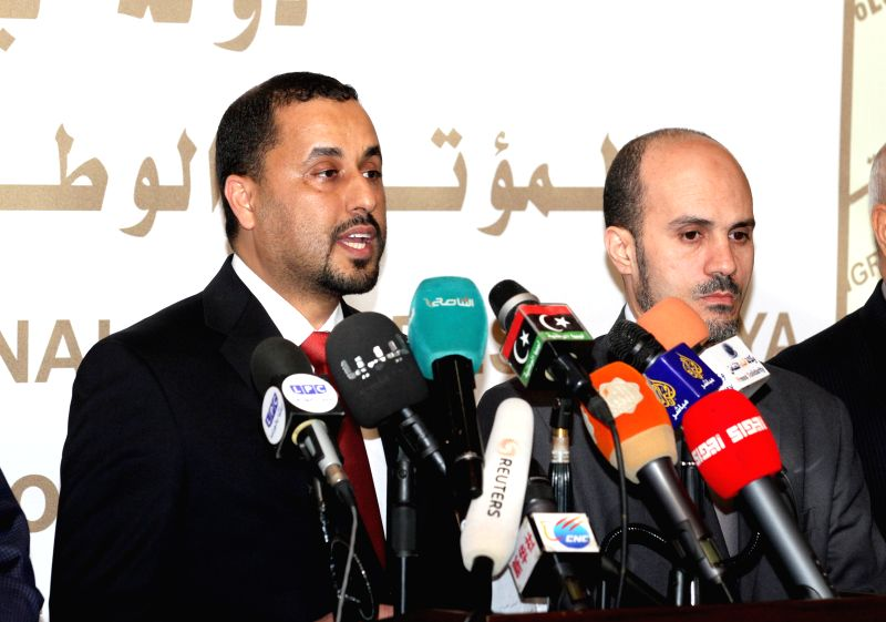 Saleh al-Makhzoum (L), second deputy of the Islamist-backed parliament General National Congress, addresses a press conference in Tripoli, Libya, Feb. 24, 2015. ...