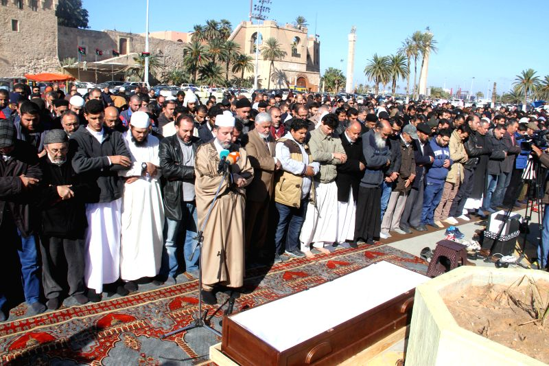 People attend the funeral of Abu Anas al-Libi in Tripoli, Libya, on Jan. 10, 2015. Abu Anas al-Libi, an Al-Qaeda suspect, died in the United States days before ...