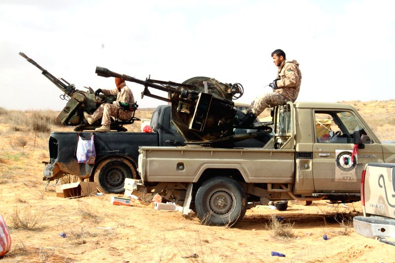 Some Libya Dawn fighters have a rest near Wetia airbase, Libya, on Jan. 5, 2015. Clashes continued between Libya Dawn fighters and pro-government forces on Monday ...