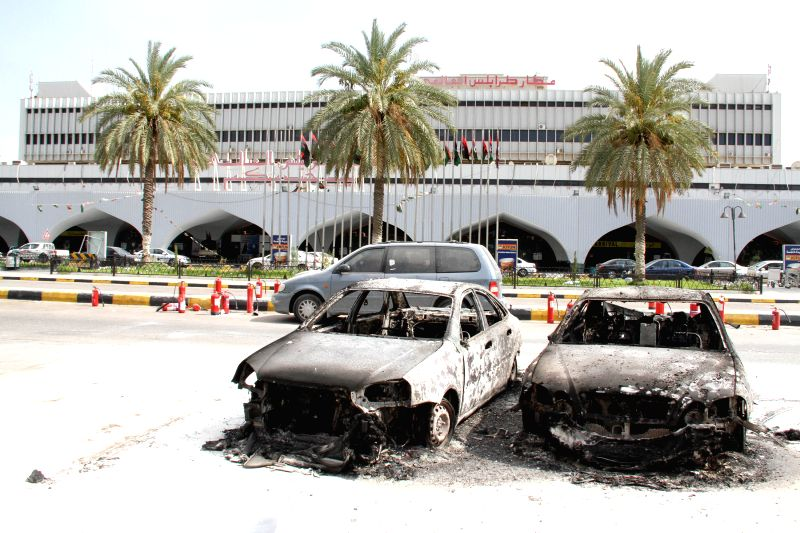 The picture taken on July 14, 2014, shows two burned cars in Tripoli International Airport, in Libya. Armed clashes broke out at Libya's international airport in ...