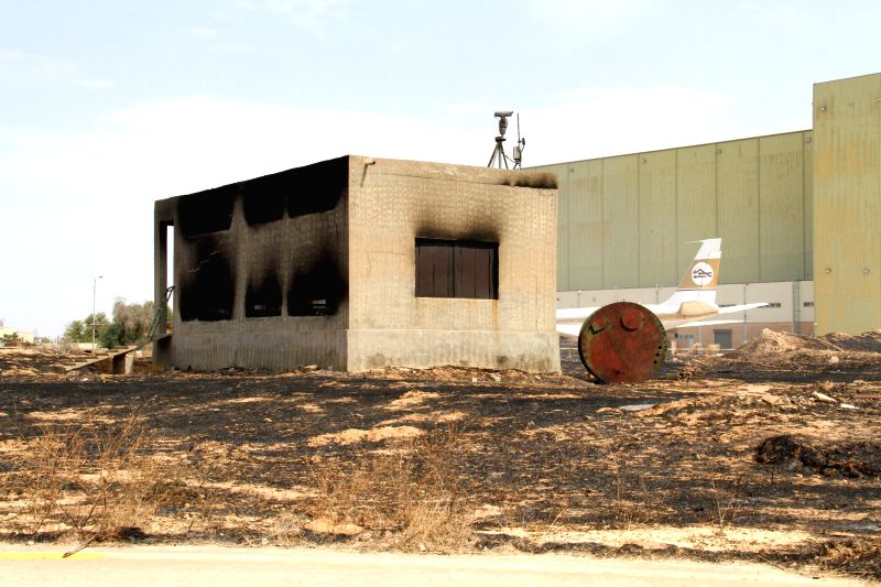 The picture taken on July 14, 2014, shows a charred power plant in Tripoli International Airport, in Libya. Armed clashes broke out at Libya's international airport