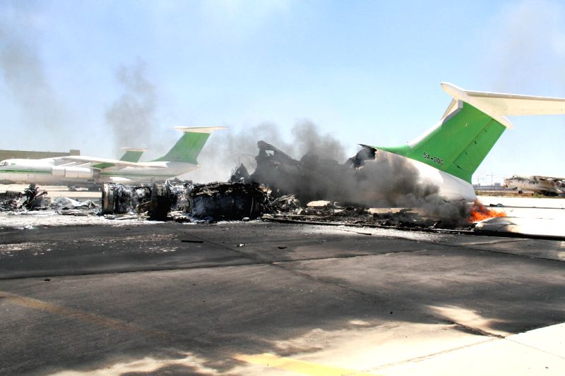 The photo taken on July 16, 2014 shows the ruin of a destroyed plane in Tripoli International Airport, in Libya. Libya's international airport in capital Tripoli ...