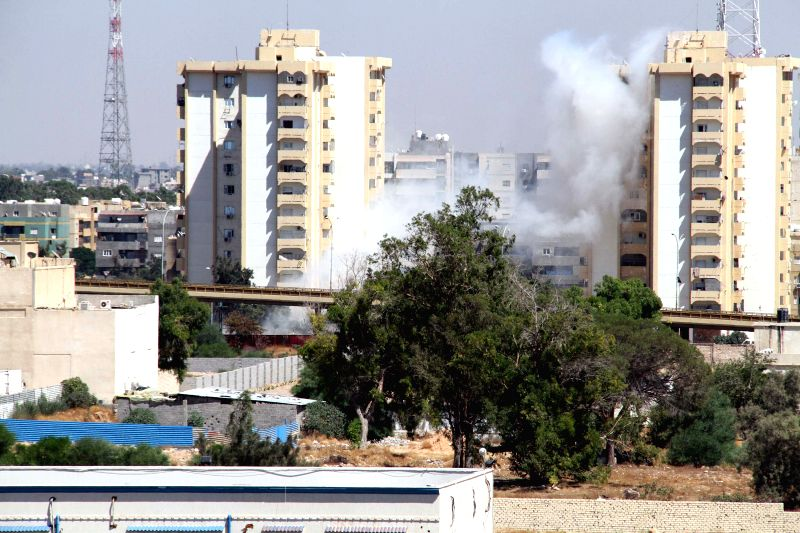 Smoke rises from the streets near Tripoli International Airport as a heavy fighting goes on between rival militia groups on July 20, 2014, in Tripoli, Libya.