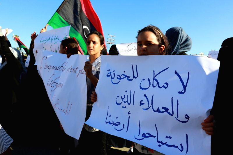 TRIPOLI, July 21, 2016 - Libyan girls hold placards during a demonstration to protest against the French military intervention at Martyrs' Square in Tripoli, capital of Libya, July 20, 2016. Three ...