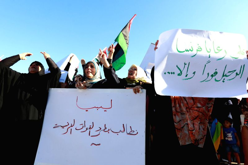 TRIPOLI, July 21, 2016 - Libyan women hold placards during a demonstration to protest against the French military intervention at Martyrs' Square in Tripoli, capital of Libya, July 20, 2016. Three ...