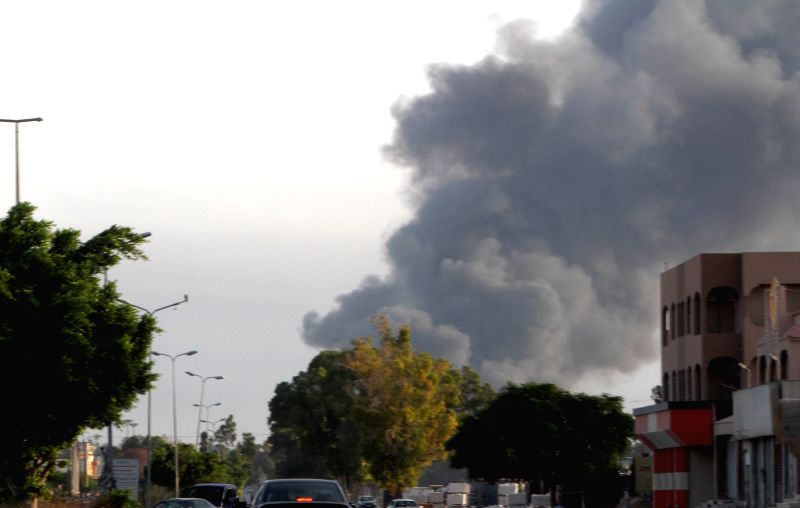Photo taken on July 24, 2014 shows smoke rising from a residential area in Tripoli, Libya. Deadly clashes erupted between Islamist fighters and pro-secular militias