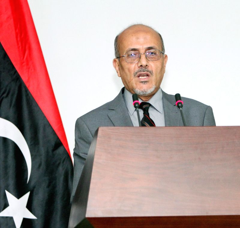 Libya's government spokesman Ahmad Lamen speaks during a press conference in the capital Tripoli on July 25, 2014. Lamen on Friday called on rival militia groups to