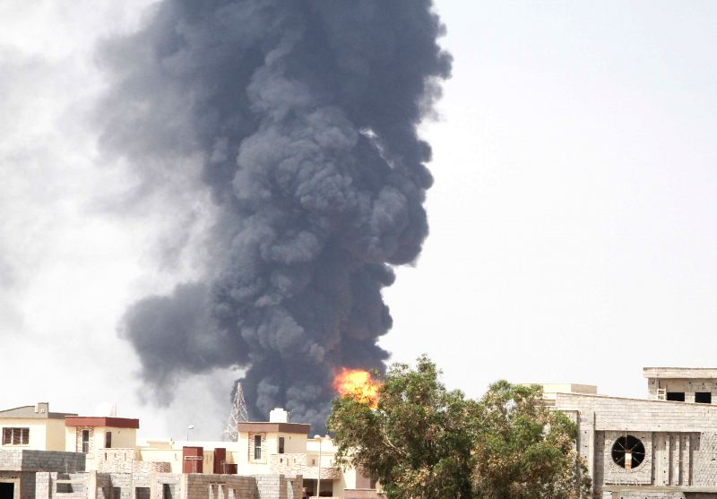 Heavy smoke rises from Brega oil-depot in Tripoli, Libya, on July 28, 2014. Shells fired by fighting rival militias fell accidentally on an oil depot on early ...