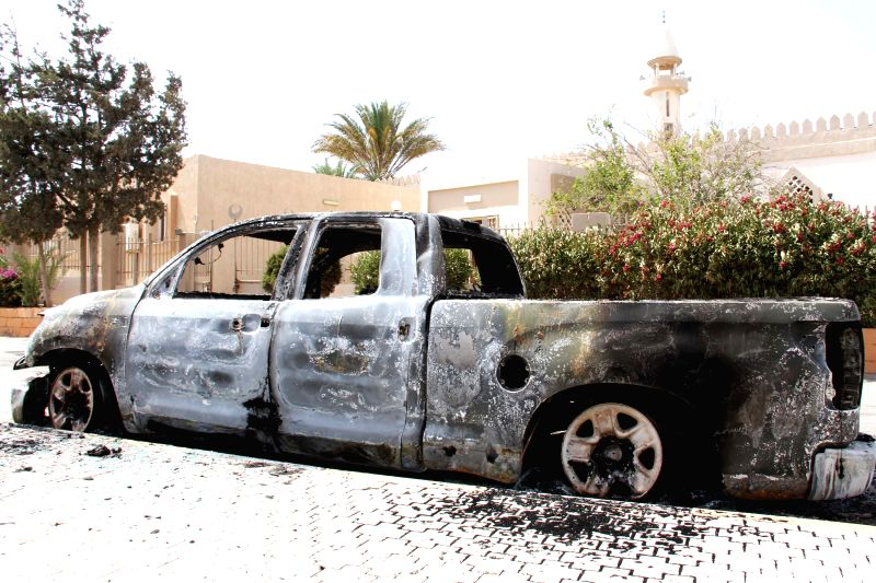 The picture taken on July 6, 2014 shows a car wreckage in Janzour area of Tripoli, Libya. Heavy fighting erupted in the Libyan capital city of Tripoli since the early