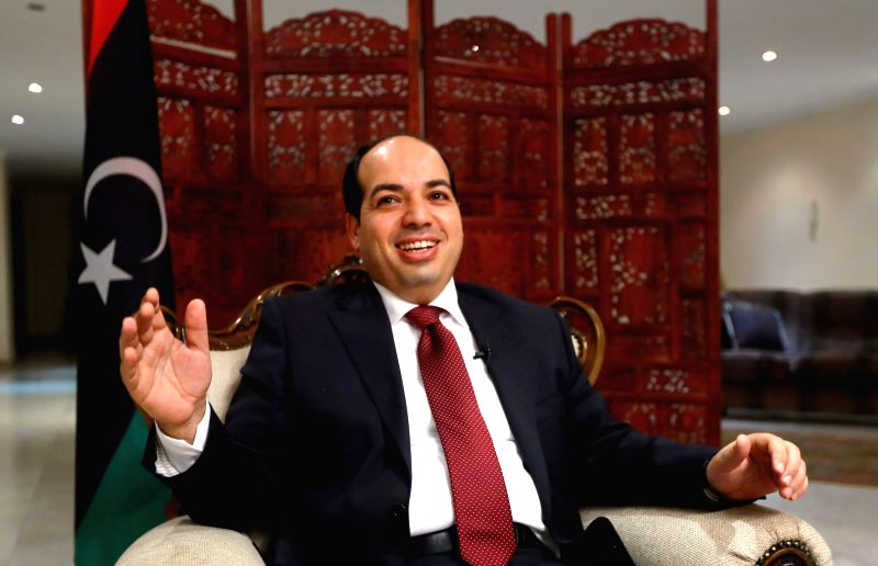 Libya's politician Ahmed Maitiq receives an interview with Xinhua in Tripoli, Libya, on July 7, 2014. Maitiq said on Monday he will again run for the prime minister ..