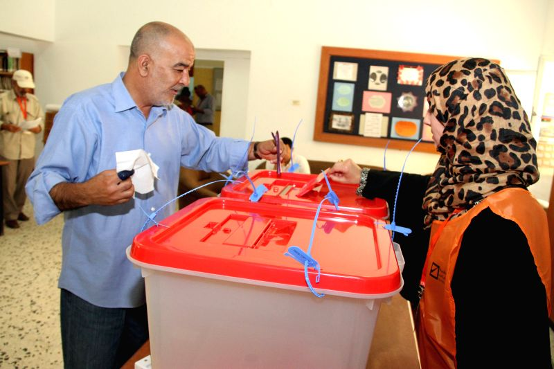 A voter casts his ballot at a polling station in Tripoli, capital of Libya, June 25, 2014. Libya held parliamentary election on Wednesday.