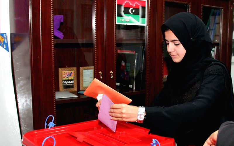 A woman casts her ballot at a polling station in Tripoli, capital of Libya, June 25, 2014. Libya held parliamentary election on Wednesday.