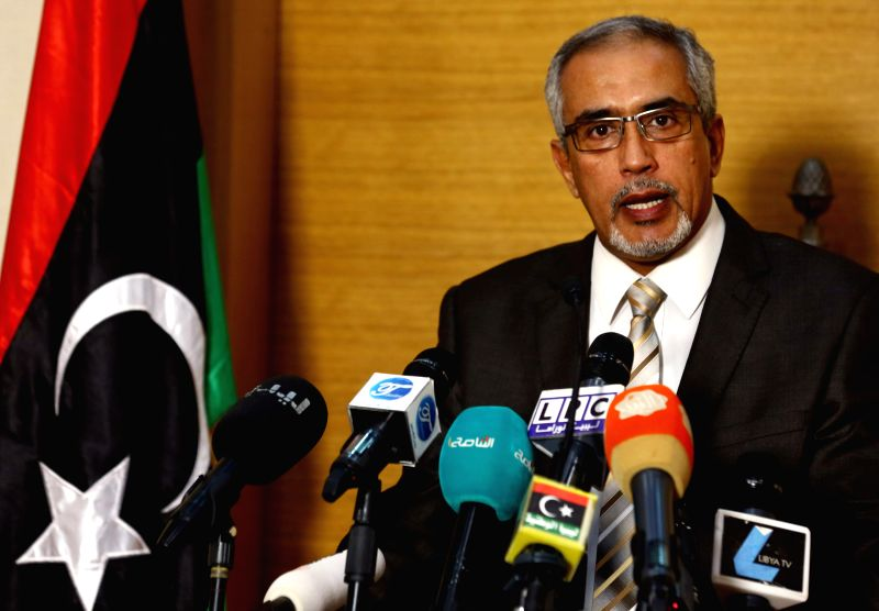 Tripoli (Libya): Libya's Islamist-backed Prime Minister Omar al-Hasi addresses a press conference, in Tripoli, Libya on Nov. 24, 2014. Al-Hasi condemned the airstrikes made by Libya's national army ..