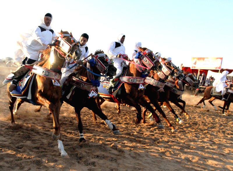 Tripoli (Libya): Libyan horse riders wearing desert costumes participate in an tradition show in Tripoli, Libya, on Nov. 26, 2014.
