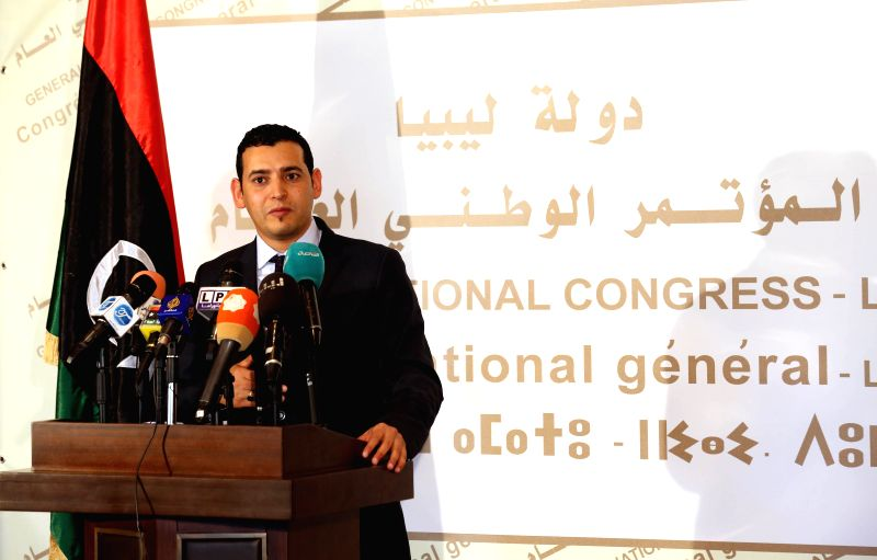 Omar Hemidan, spokesman of the General National Congress (GNC), Libya's Islamist-backed parliament, addresses a press conference in Tripoli, Libya, on March 31, ... - Omar Hassi