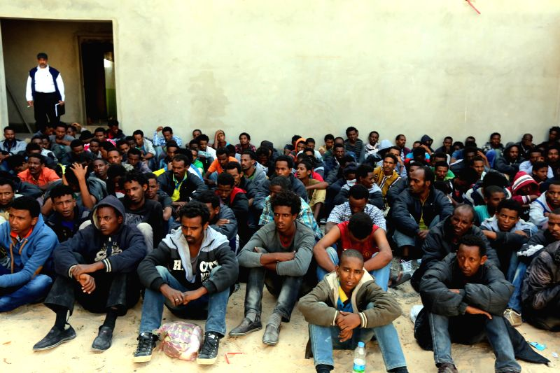 Illegal migrants sit inside a police center in the coastal town of Zawiya, west of Tripoli, capital of Libya, on May 12, 2014. Around 400 migrants were arrested off .
