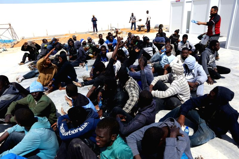 TRIPOLI, May 23, 2017 - Illegal migrants from Africa sit at a gathering point after being rescued by Libyan coast guards off the coastal town of Tajoura, 15 kilometres east of the capital Tripoli on ...