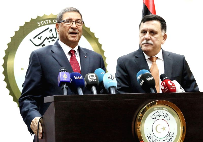 TRIPOLI, May 6, 2016 - Tunisian Prime Minister Habib Essid (L) speaks during a press conference with Fayez Sarraj, prime minister of the UN-backed Libyan unity government, in Tripoli, capital of ... - Habib Essid