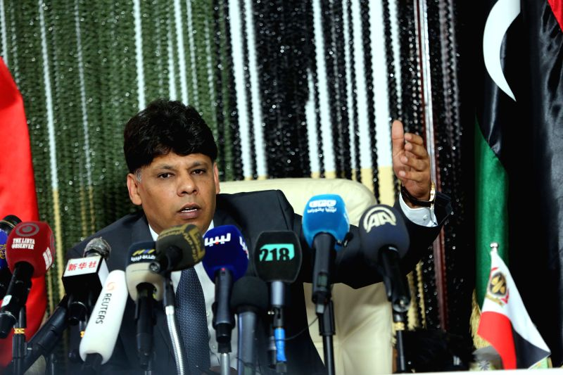 TRIPOLI, Sept. 29, 2017 - Al-Siddiq Al-Sour, head of the investigation bureau in the Libyan Attorney General's office, speaks during a press conference in Tripoli, Libya, Sept. 28, 2017. Initial ...