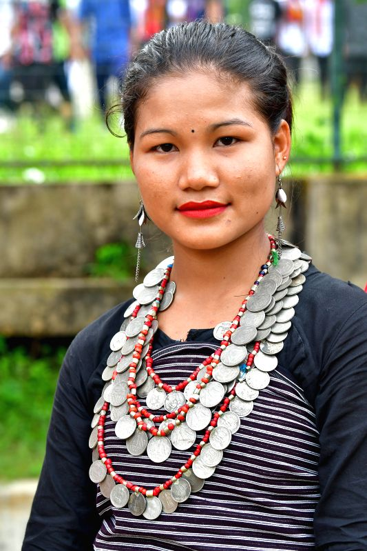 TRIPURA, Aug. 9, 2018 - A woman in traditional attire participates in a celebration of the International Day of the World's Indigenous Peoples in the outskirts of Agartala, capital of the ...