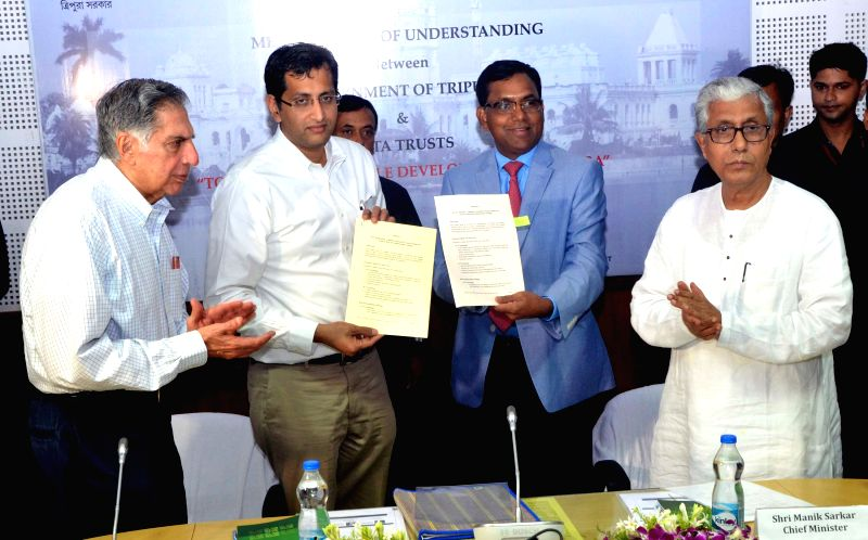 Tripura Chief Minister Manik Sarkar and Tata Group Chairman Ratan Tata duing the MoU signing function in Agartala on July 9, 2015.