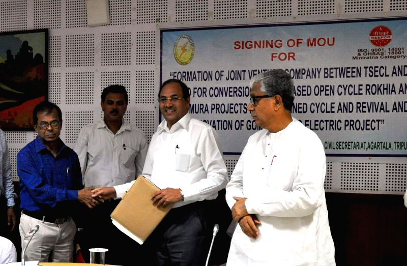 Tripura chief minister Manik Sarkar (R) witnesses the signing of a Memorandum of Understanding between Tripura State Electrical Corporation Limited (TSECL) CMD S K Ray (L) and North Eastern Electric . - Manik Sarkar
