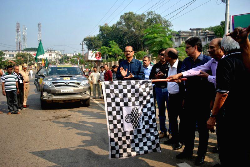Tripura Chief Secretary Y P Singh flags off the third leg of the Bangladesh, Bhutan, India and Nepal (BBIN) Friendship Motor Car Rally from Agartala on Nov 28, 2015.