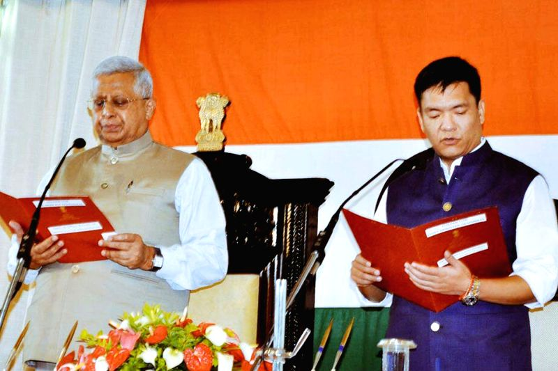 Tripura Governor Tathagata Roy administered oath to Congress leader Pema Khandu as the Chief Minister of Arunachal Pradesh during swearing-in ceremony in Itanagar on July 17, 2016. - Tathagata Roy
