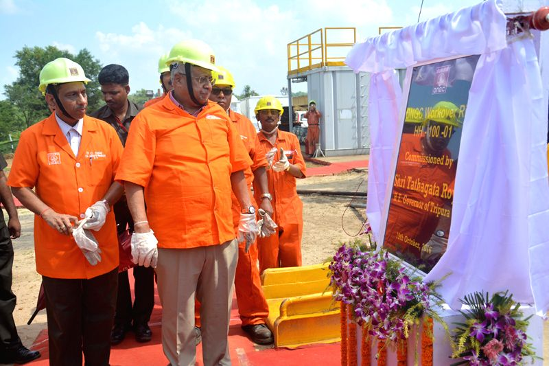 Tripura Governor Tathagata Roy (middle) switching on the ONGC rig in Kunjaban field in western Tripura. ONGC Executive Director S. C. Soni (left side of governor) looks on.