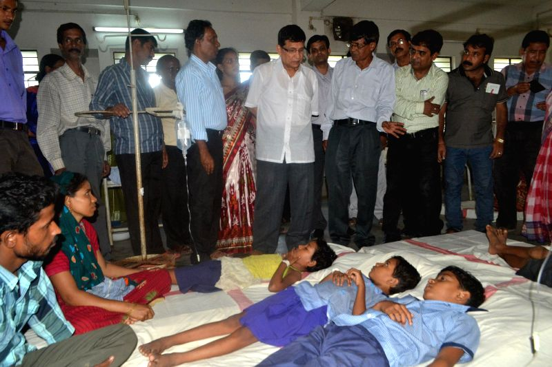 Tripura Health Minister Badal Chowdhury visit students who were taken ill after consuming midday meal at a hospital in Bishalghar of Tripura on Aug 28, 2014. - Badal Chowdhury