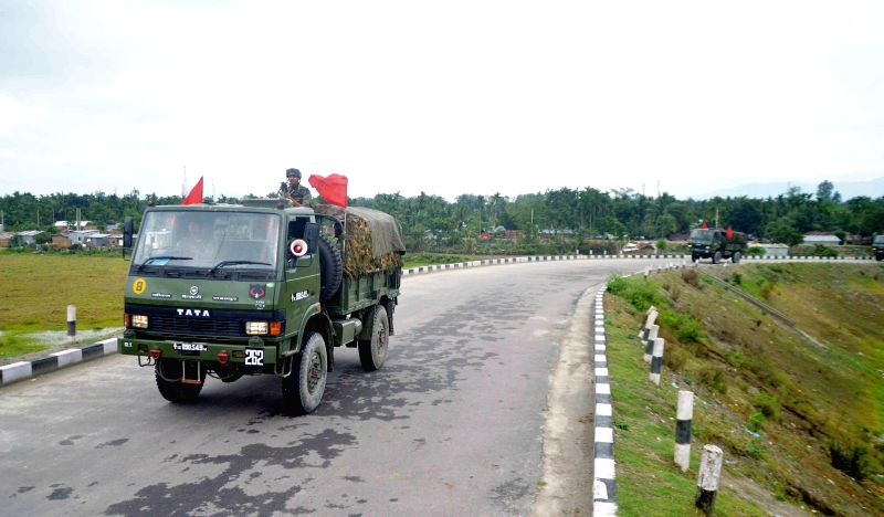 Troops of Indian Army's Red Horn Division patrol the deserted roads of violence struck BTAD area of Assam on May 4, 2014.