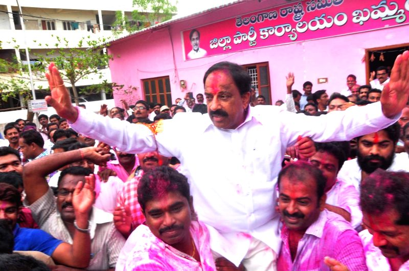 TRS candidate Tummala Nageshwara Rao celebrates with party workers after winning Palair assembly constituency, in Hyderabad on May 19, 2016. - Tummala Nageshwara Rao