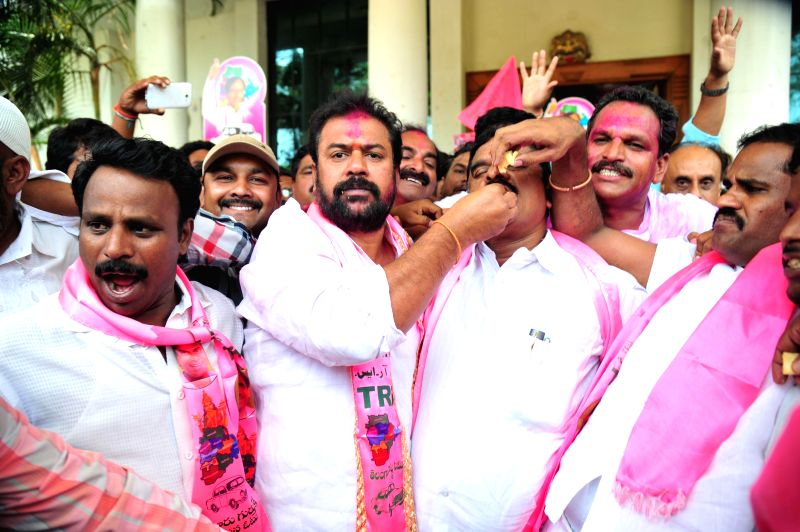 TRS workers celebrate their performance in 2014 Lok Sabha elections in Hyderabad on May 16, 2014.