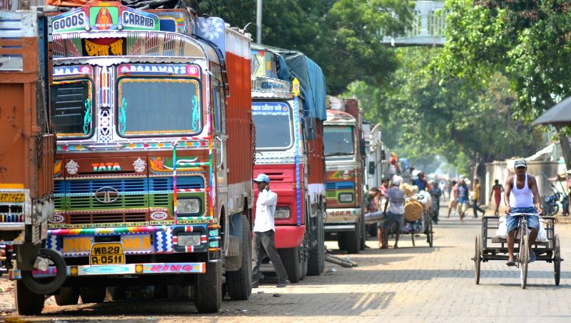 Trucks remain parked as truck owners and operators launched an indefinite nationwide strike against increasing diesel prices and a sharp hike of third party insurance premium; in Kolkata on ...(Image Source: Kuntal Chakrabarty/IANS)