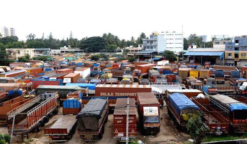 Trucks remain parked at a depot during an indefinite nationwide strike called by truck owners and operators against increasing diesel prices and a sharp hike of third party insurance ...