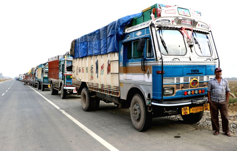 Trucks remain stranded on Jammu-Srinagar Highway at Pampore after protesters pelted stones at Lethpora, Awantipora in Jammu and Kashmir's Pulwama district on Aug 8, 2016.