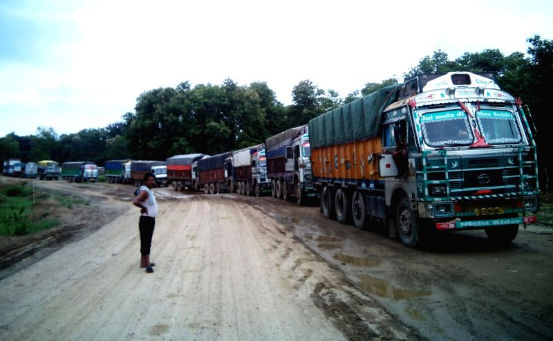 Trucks stranded on National Highway 8 (earlier NH44) as damaged highway and torrential rain is hampering the repairing work of the 20 kilometer stretch, on the highway, at Lowerpowa in ...