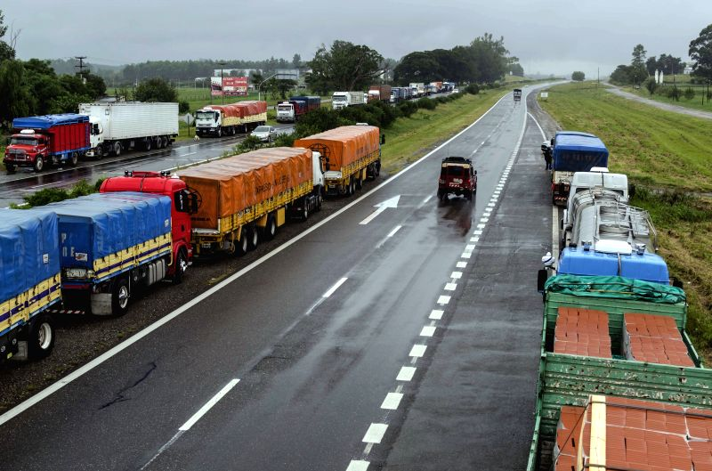 Trucks are seen stopped during the general strike day in Tucuman, Argentina, on March 31, 2015. The strike across the country was called by the General Workers ...