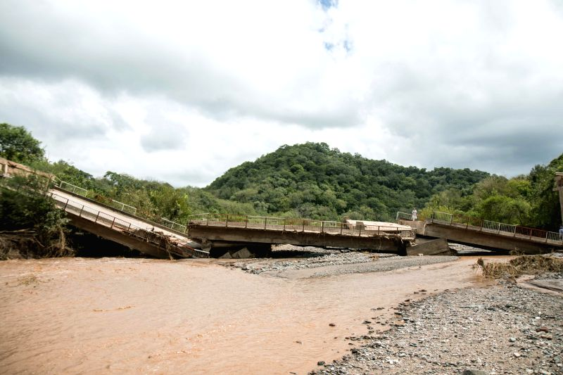 View of a collapsed bridge over the La Sala River, in Tucuman, Argentina, on March 9, 2015. According to local press, the bridge that connects El Sunchal with Villa ...