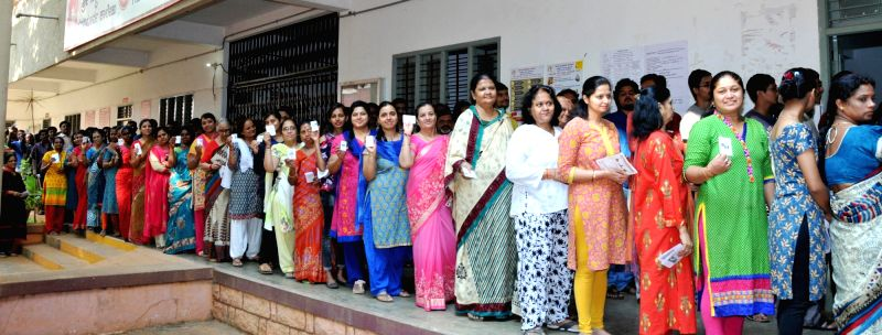 Tumakuru: People stand in multiple queues to cast their votes for the second phase of 2019 Lok Sabha elections, at a polling station in Karnataka's Tumakuru, on April 18, 2019. (Photo: IANS)