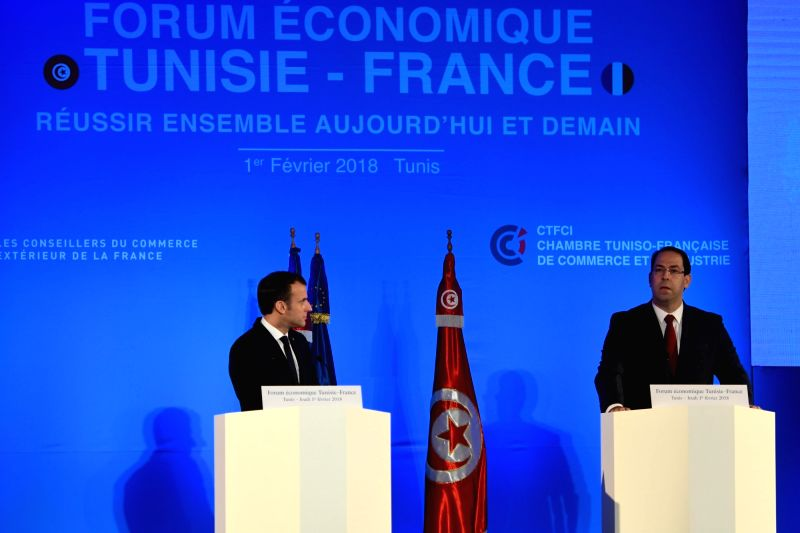 TUNIS, Feb. 2, 2018 - French President Emmanuel Macron (L) and Tunisian Prime Minister Youssef Chahed attend the Tunisia-France economic forum in Tunis, capital of Tunisia, Feb. 1, 2018. - Youssef Chahed