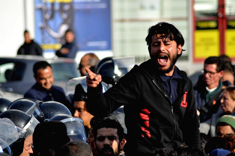 TUNIS, Jan. 27, 2018 - A man shouts slogans during protests against rising prices and tax increases in Tunis, capital of Tunisia, on Jan. 26, 2018.